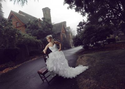 Bride posing with a chair