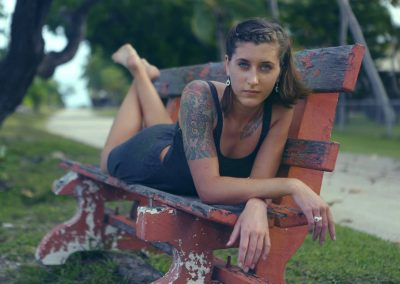 Girl with tattoo on bench